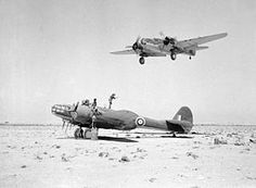 Royal Air Force Maryland Mark II, of No. 39 Squadron RAF, undergoes servicing on a landing ground in the Western Desert as another aircraft returns from a reconnaissance flight, Egypt. c 1941 Aircraft Photos, Ww2 Aircraft, Military Aircraft, Martin Aircraft, Afrika Corps, Oshkosh Wisconsin, North African Campaign, Ww2 Planes, Vintage Airplanes