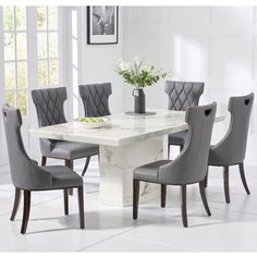 The Verbier Grey V Pedestal Marble Dining Table with Freya Chairs set seats up to 8 people. This contemporary dining set features a large grey marble dining table and faux leather dining chairs. Marble Dining Table Set, Grey Dining Tables, Luxury Dining Tables, Dining Room Table, Dining Area, Dinning Set, Dining Decor, Dining Chair Set, Dining Rooms