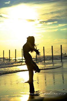 yuka on the sunset beach by higehiro, via Flickr