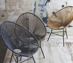 The Acapulco chair reimagined by Roost; the Ellipse Chair features a tonal dyed cotton cord seat and an iron frame