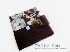 HANDMADE vintage wallet brown velour with printed flowers fabric in brown, beige and sky blue color. 2 compartments for business cards, credit card, health insurance card etc... 2 big pockets for your identity card, driving license etc ... It has a satchel-style clasp. Size when open: 12x12,5cm