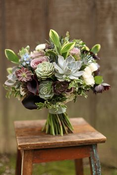 Purple, blue and mint green succulent bridal bouquet with callas, hellebores, Amnesia roses, tweedia, thistle, ranunculus, eucalyptus and Solomon's seal. By Cincinnati wedding florist Floral Verde.
