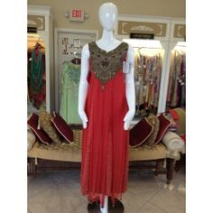 Threadwork done by hand on this rose color outfit by designer Mehdi - available at JIYA Designs