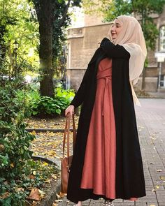 Image may contain: 1 person, standing and outdoor Hijab Stile, Hijab Chic, Hijab Fashion, Mantel, Shades, Instagram, Outdoor, Image, Style