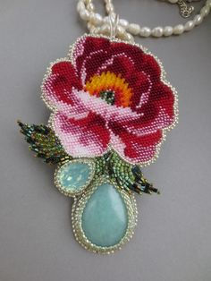 The cross stitch pattern for this rose is posted on this site, albeit w/out a color list.