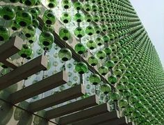"""""""The building that got my attention is  a small apartment building in a quiet residential road of the Polando district of Mexico City. The main structure is of reinforced concrete, but what makes it unique is the use of 7,900 blown green glass spheres on the façade and inside the building. """" - Building by Hierve-Diseñería"""