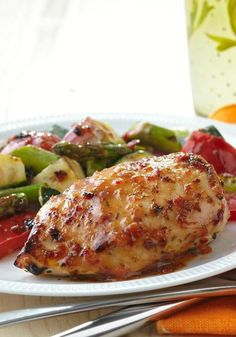 Grilled Chicken with Savory Summer Vegetables -- What do we love about this healthy living recipe? It's a quick and easy way to get low-cal, delicious food on the dinner table.