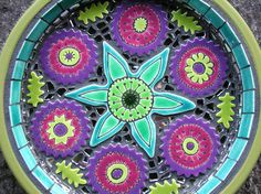 Mosaic bird bath by Clare Dohna