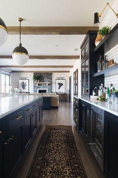 Black kitchen, vintage rug, farmhouse style