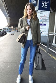 spring fashion, fall fashion, spring outfit, fall outfit, street style, street chic style, casual outfit, comfy outfit, airport outfit - military green bomber jacket, white t-shirt, mom jeans, white sneakers, olive suede shoulder bag, olive weekender bag