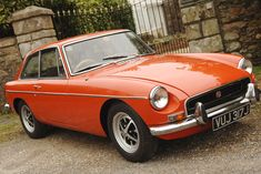 """I used to own an MGB GT just like this: a lovely classic that I used as everyday transport. My Grandfather owned one of the first MG's and in the 1974 model, I liked to think I owned one of the last """"true"""" MG's, before legislation introduced rubber bumpers etc."""