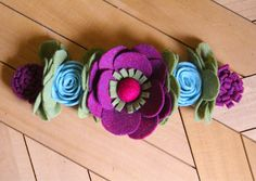 A personal favorite from my Etsy shop https://www.etsy.com/listing/573761793/purple-flower-crown-blue-felt-flowers