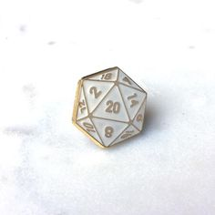 Weapon of Choice D20 White Lapel Pin – $8 USD