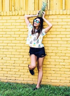 pineapple t-shirt. High waisted cut off black shorts. a cute summer outfit!