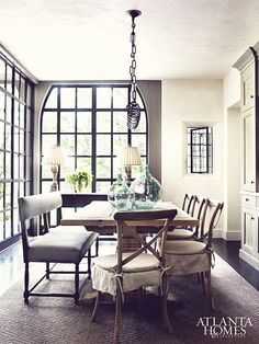 Another example of a rustic interior with industrial steel windows - via Dustjacket
