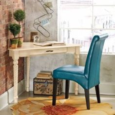 Love the color on this blue chair. $249