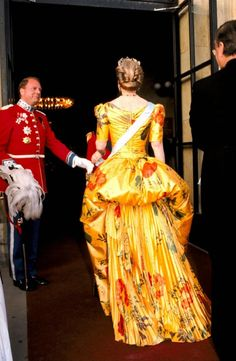 The Queen Margrethe ll of Denmark, in yellow...