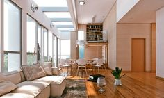 Love everything about this room! The clear ceiling letting the sun in, the library above the dinning room, everything just... FITS!