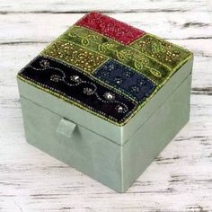 This handmade creation is offered in partnership with NOVICA, in association with National Geographic. Applied by hand to colorful velvet, beadwork sparkles on this diminutive jewelry box. Seema in In