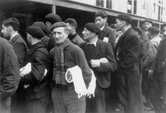 Jewish men in Drancy, France queuing for disinfection, 3rd December 1942.