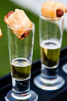 Adorable cocktail hour idea! These pigs in a blanket and shots of beer would be a perfect hors d'oeuvre to serve in your wedding cocktail lounge! {Milan Catering and Event Design}