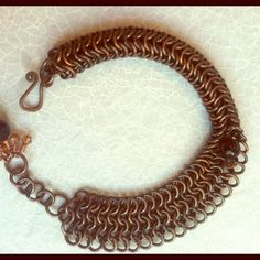 COPPER HANDWOVEN CHAINMAILLE BRACELET One of my most favorite pieces that I have created. Nestled in the middle of the bracelet is an onyx bead and at the pretty dangle end piece is another onyx bead accented with Swarovski crystals. Jewelry Bracelets