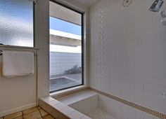 The large master suite has two closet areas, wonderful step-down shower and it's own private patio.