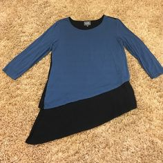 Blue Asymmetrical Breastfeeding/Nursing Top Soft blue and black color blocked asymmetrical top by Milk Nursingwear. Top layer lifts up for easy feeding. Small stain near lower left hem as shown in pictures. No rips or holes. 3/4 length sleeves. 94% rayon, 6% spandex. Milk Nursingwear Tops Tunics