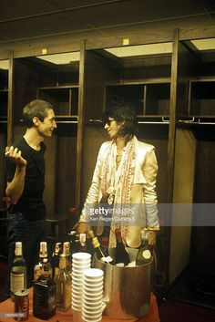 Charlie Watts and Keith Richards of the Rolling Stones are photographed backstage in the 1970's.