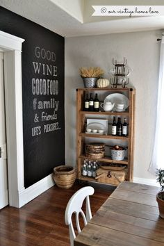Dining room storage. Love the painted wall