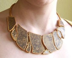 Asymmetrical statement necklace browns and golds polymer clay bib necklace irregularly shaped tiles. $54.50, via Etsy.