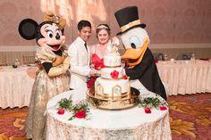 Top Orlando wedding photographer and videographer capture fun themed wedding at Disney's wedding pavilion at the grand floridan in Orlando