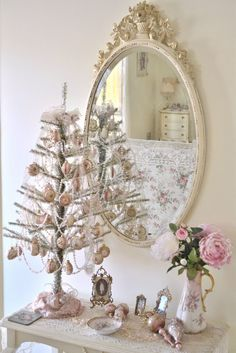 Shabby Chic Christmas, but I'd hate to put it away! just got a white tree like that, love it. Noel Christmas, Pink Christmas, All Things Christmas, Christmas Mantles, Christmas Houses, Xmas, Christmas Villages, Christmas Ornaments, Shabby Chic Christmas