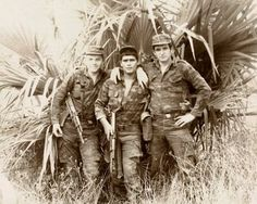 Cuban soldier poses with a pair of Soviet Marines somewhere in the suburbs of Luanda. Photo taken sometime during