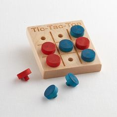 Beautiful little wooden tic tac toe game fat Land of Nod, perfect travel toy.