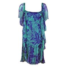 1970's Galanos Blue Purple Floral Silk-Chiffon Draped Flutter Dress | From a collection of rare vintage evening dresses at https://www.1stdibs.com/fashion/clothing/evening-dresses/