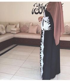 I feel like if the white design on the abaya was the color of her hijab, it would be on point.