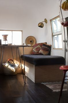 July 2015, Olympic National Park, Washington Dining and living space. Lighting was provided by Schoolhouse Electric. Pillows were thrifted from House of Vintage in Portland, Oregon. The custom table was crafted from salvage planksfound at the Rebuilding Center in Portland, Oregon, and the hairpin legs were purchased from a vintage shop on Division Street. The …