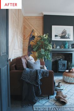 """In just under a month, this living room went from cozy and sun-soaked to the homeowner's favorite aesthetic: """"boho surf-scandi."""" And while the photos reveal that the wall is in somewhat rough shape, just wait until you see the walls now..."""