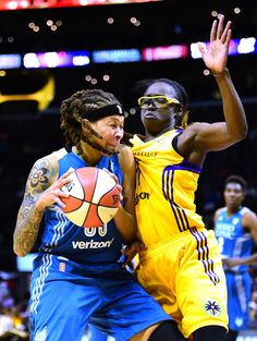 Guard Seimone Augustus #33 of the Minnesota Lynx attempts to drive on forward Essence Carson #17 of the Los Angeles Sparks at Staples Center on October 16, 2016 in Los Angeles, California.  NOTE TO USER: User expressly acknowledges and agrees that, by downloading and or using this photograph, User is consenting to the terms and conditions of the Getty Images License Agreement.