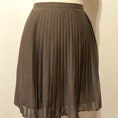 "J. Crew Silk Blend Taupe Pleated Mini Skirt J. Crew Factory Store chiffon pleated skirt. Ridge waistband with side invisible zipper closure. Fully lined.   83% viscose 17% silk  Dry clean only  16"" overall length J. Crew Skirts Mini"