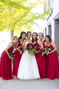 Swoon! Loving the red color of these chiffon @davidsbridal bridesmaid dresses! {Dianne Personett Photography}