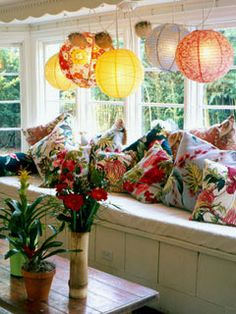 how fun are these lanterns above the window seat and SUPER FLUFFY CRAZY PILLOWS?