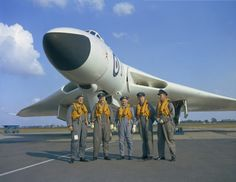 The crew of an Avro \'Vulcan\' bomber pose infront of their aircraft. This aircraft is from 230 Operational Conversion Unit (OCU) at RAF Waddington, Lincolnshire, in Military Jets, Military Aircraft, Vickers Valiant, V Force, War Jet, Avro Vulcan, Delta Wing, War Thunder, Navy Aircraft