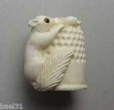 Carved squirrel thimble