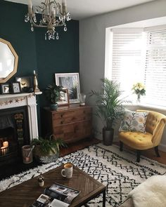 Where I like to live Warm, medium-light wooden floor; Turquoise walls replace chimneys and neutral t Turquoise Walls, Teal Walls, Teal Rooms, New Living Room, My New Room, Dark Green Living Room, Living Room Yellow Accents, Living Room Decor Teal, Warm Colours Living Room