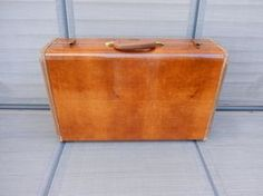 vintage Samsonite suitcase, weekend travel case from the 1950s, hard back case covered in a marbled caramel color faux leather with a with hard