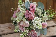 Spring bouquet of lilac, ranunculus and roses
