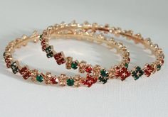 Costume Indian Fashion Jewelry Bangle set with Green,Red and Topaz stones studded-02BAN13  http://www.craftandjewel.com/servlet/the-1766/Costume-Indian-Fashion-Jewelry/Detail