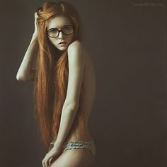 redhead in just her glasses